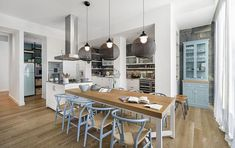 Wishbone chairs at the dining table add timeless charm to the dreamy interior - Decoist
