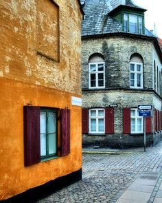 The row of yellow old buildings known as,Nyboder, used to be the district of former Naval barracks in #Copenhagen. #travel #Denmark