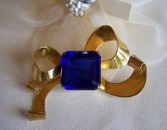 A Vintage Signed Coro Sterling Vermeil Blue & Gold Bow Brooch.