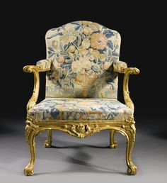An important pair of George II tapestry-upholstered giltwood armchairs in the manner of Thomas Chippendale circa 1755