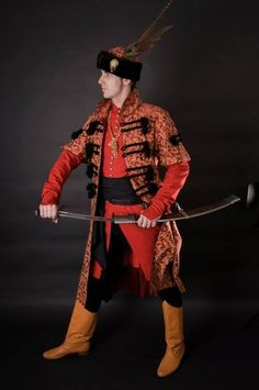 Tailor's - Lenka, Brocade mentieka, part 2 = A man's Hungarian clothing from the middle of 17th century is composed of a red dolman, a brocade mentieka with black pozaments, a black tight trousers and a fur hat.