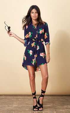 Mini shirt dress in navy with oversize rose floral print. Dip back and tie waist for a flattering fit.  Shop now.