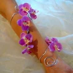 A stunningly beautiful arm band with dendrobium orchid blossoms, $35