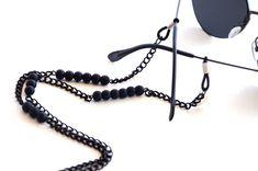 Black sunglasses holder with black lava stones 🖤 Tiger Eye Beads, Eyeglass Holder, Delicate Jewelry, Steel Chain, Womens Glasses, Black Sunglasses, Steampunk, Black Glass, Eyewear
