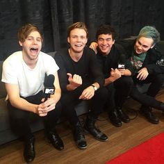 Luke - look how big my mouth is Ash - that is disgusting like put it away Michael - come here Calum let's cuddle Calum - stop touching me Michael I need to look happy