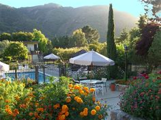 The pool at Country Garden Inns in Carmel Valley, California overlooks the beautiful valley
