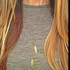 Two leaf drop down gold layer necklace Two leaf drop down gold layer necklace Material: alloy Jewelry Necklaces