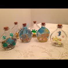 Fun project with my grand kids for a beach center piece, bottles from Michael's, sand & shells they picked up, paint & their imagination
