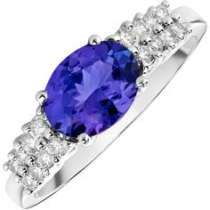 Slim and always fashionable, this ring boasts a stunning oval-cut tanzanite (1.40 ctw), flanked by rows of glittering round diamonds (.25 ctw), set in 14k white gold.