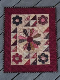 I love this doll quilt!