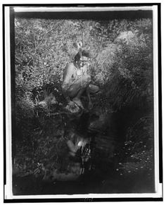 inch Canvas Print (other products available) - CURTIS: CROW MAN, <br> A Crow Native American man in Montana gazing at his reflection in a pond. Photograph by Edward Curtis, - Image supplied by Granger Art on Demand - Box Canvas Print made in the USA Native American Men, American Indians, Crow Indians, American Traditional, Old Photos, Vintage Photos, First Nations, That Way, Pet Birds