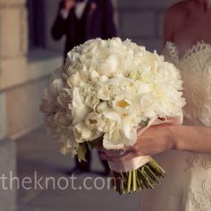 Spray roses, white tulips and white peonies in full bloom.Simple structure but a large bouquet with great textures