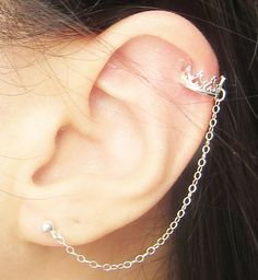 Item #CE382    Features the classic cuff earring design but with the princess crown ear cuff.    - Ball stud: 3mm  - Chain length: 6cm  - ear