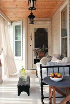 I like everything about this porch, but could see my cats hanging on the curtains.  Beautiful  porch.