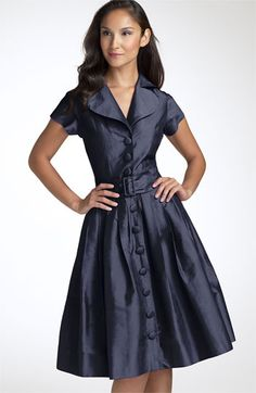 Teri-Jon.  Not available any more.  Rich, high-sheen silk is fashioned into an updated dress with rounded collar and covered buttons. Inset back waist wraps to an attached front belt with silk-wrapped buckle. Pleats create volume through the skirt for beautiful flare.