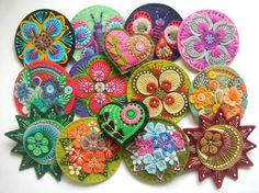 Felt brooches  I love these. Lots of detail, felt and embroidery. They'd make nice ornaments, too