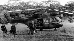South African soldiers board a Puma helicopter during the Border War, in the (Collection of HR Heitman) Once Were Warriors, Augusta Westland, South African Air Force, World Conflicts, Korean War, African History, Special Forces, Helicopters, Military History