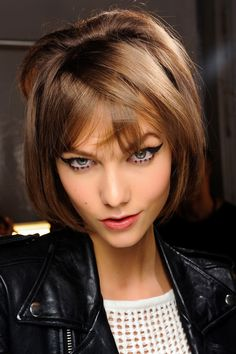 Karlie Kloss in 20 make-up looks: Backstage at Ann Sui Fall/Winter 2013-2014