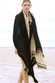 Raffia Wrap. Wool with decorative raffia trim.