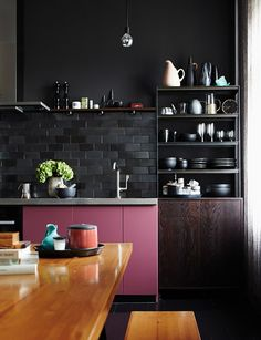 Modern dark kitchen w pink cabinets matte black subway tile backsplash | Berlin home of German stylist Peter Fehrentz