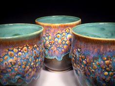 Fantastic mugs by Panta Rei Design / Louise Bouchard. Amaco Potter's Choice glazes: Oatmeal over Iron Lustre with Tourmaline on the inside. http://www.pantareidesign.ca/