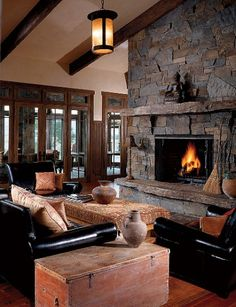 Dennis Quaid's home in Montana. Loving the rustic & somewhat 'mission' type style combo.