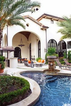Beautiful outdoor areas in this Mediterranean-style home. The covered area is great for when there's too much sun or the occasional summer rain shower.