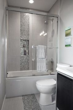 Bathroom Remodel Gray Tile bathroom with bathtub and gray subway tile shower surround with