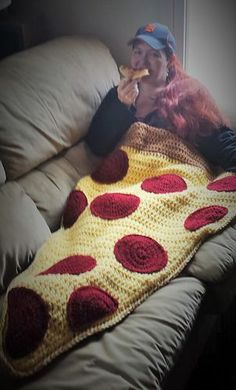 hilarious! A crocheted pizza sleeping bag snuggy couch cuddly thing!
