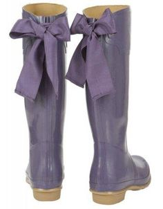 Wellington rubber boots with bows on the back. Black or purple! <3 so cute for rainy days!!