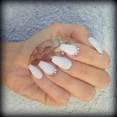 Matte white stiletto nails with studs