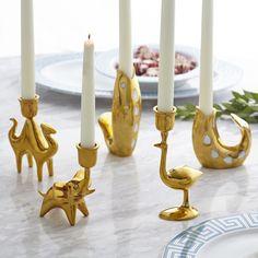 Liven up your dining table with brass candleholders