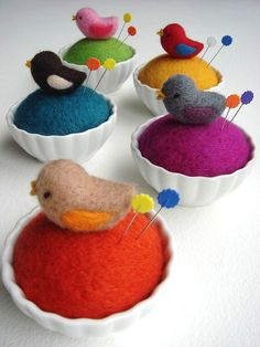 Such cute felt pin cushions!  A little birdie is perched on it :)