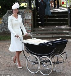 Kate, dressed all in white, pushed Charlotte in the coach-built pram made by Millson at her christening