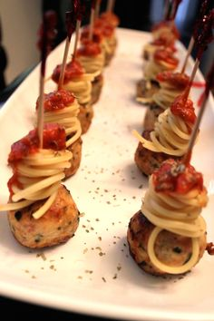 Spaghetti and meatball appetizer. Cook them separately, then unite them on a skewer, drip some pasta sauce and sprinkle some spices. Voila!!