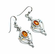 A pair of sterling silver (stamped 925 on the backs) dangle drop pierced hook earrings set with faux amber stones. They are in reasonably good condition given their age and previous usage, although they may need a little cleaning depending on your preference. | eBay!