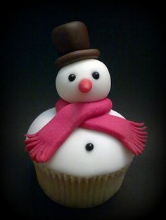 Christmas Snowman Cupcake I have to try to do this with Rafaello Ferrero