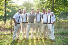Tan slacks, white shirts and suspenders. With the groom in a vest..so easy. Who needs a tux? -- I absolutely love this. Best idea yet. I'm thinking something similar but different colors.