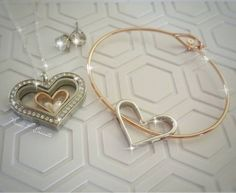 Nesting Hearts, comes as a set of three in silver and rose gold ...wear the Large Nesting Heart on a Core Bangle Bracelet, all three inside the Large Heart Locket, add a pair of Crystal Stud Earrings for a great look! These can all be found online at: www.BeHOOTifulLocketts.OrigamiOwl.com Follow me @ facebook.com/KarenBrownSchoenfeldt