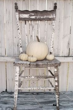 Old Rustic Chair with Pumpkins on the Seat