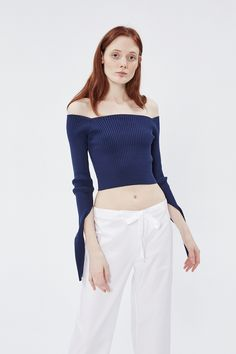 """<span style=""""background-color: #ffffff;"""">Minimalistic silhouette and asymmetric lines is the main Jacquemus's signature. Navy off-the-shoulder ribbed cropped top with extra-long sleeves that can be worn draped or folded over. Wear it with <a href=""""/catalog/product/73110"""">high-waisted skirts</a> or <a href=""""/catalog/product/73138"""">pants</a>.</span>"""