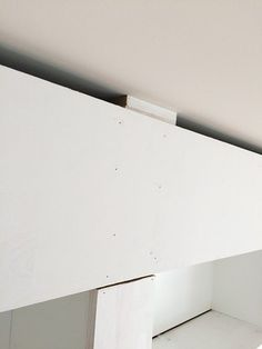 How to DIY the look of built-in library bookcases from IKEA Billy bookcases (IKEA hack). Includes step by step tutorial instructions for measuring, building, and finishing along with a source list.  |  11 Magnolia Lane