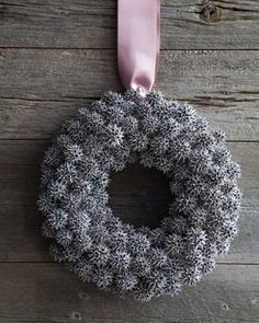 Christmas Wreaths Inspiration : Spray paint those pesky gumballs from your tree and transform them into your Front Door Decor