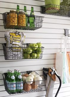Hanging wire baskets on slat wall. Great in a basement, garage or pantry Diy Kitchen Storage, Pantry Storage, Kitchen Pantry, Garage Storage, Storage Room, Storage Baskets, Food Storage, Shelves In Kitchen, Kitchen Racks