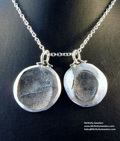 Daughter's fingerprints and names on the back of each pendant make this a special piece for mom to wear.