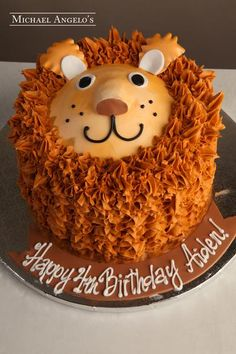 Description This cake is iced in buttercream using a technique that looks just like a baby lion's fur. A friendly face is topped off for a fun and unique des