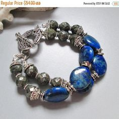 A fabulous variety of gemstones, compliment each other so well in this funky piece. This stunning piece is made with two strands of Lapis Oval beads and Pyrite gemstones.Sandwiched between the gemstones are silver spacers. The beautiful silver plated hammered toggle clasp adorn this piece. It will fit a 6 1/2 inch to perfection and I can easily adjust if needed. Enjoy....