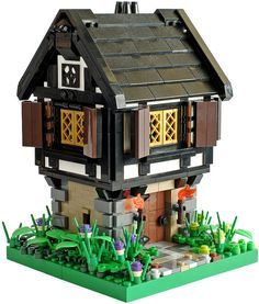 cute little black and white Tudor style cottage. i love the ground floor with the stone corners and the front door, and the second story is amazing-its a perfect tudor style cottage. something i would expect to see in a fairy tale or a movie.. just goes to show you that awesome lego creations don't have to be these huge, giant houses- its all in the details.....