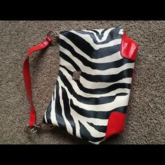 Dooney & Bourke purse Black/white/red animal print Dooney and Bourke purse; received for Christmas one year and only used a few times Dooney & Bourke Bags Shoulder Bags