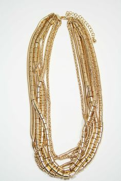 Gold Goddess Necklace--make in one color strands with the cylinder colored beads I just bought